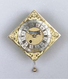 A miniature brass wall clock