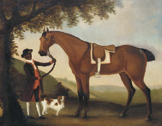 A saddled hunter held by a gro
