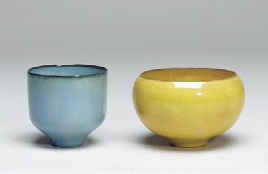 A BLUE-GLAZED AND A YELLOW-GLA