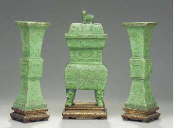 A GREEN-GLAZED CERAMIC THREE-P