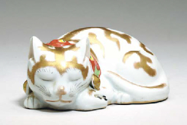 A HIRADO PORCELAIN FIGURE OF A CAT,