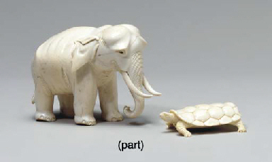 TWO CARVED IVORY FIGURES OF EL