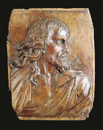 A CARVED WOOD PLAQUE OF A MAN
