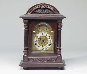 A GERMAN MAHOGANY MANTLE CLOCK