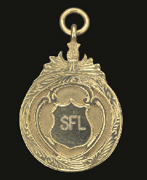 A 9CT GOLD INTER-LEAGUE MEDAL