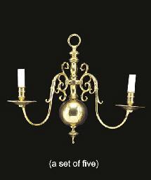 A set of five polished brass t
