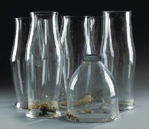 A GROUP OF SIX GLASS STORM SHA