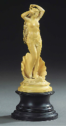 A CARVED IVORY FIGURE OF VENUS