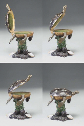 A CARVED AND DECORATED TURTLE