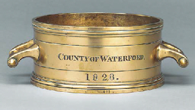 AN IRISH BRASS IMPERIAL GALLON