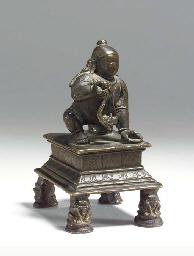 A Bronze Figure of Baby Krishn