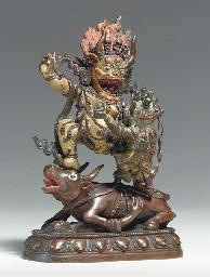 A Polychromed Bronze Figure of
