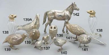 A MODERN SILVER HORSE ORNAMENT