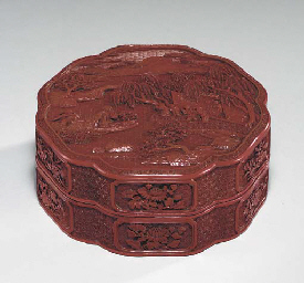 A CARVED RED LACQUER HEXAGONAL