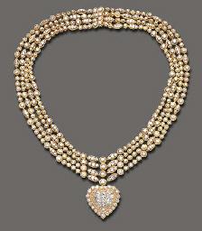 A DIAMOND PENDANT NECKLACE, BY