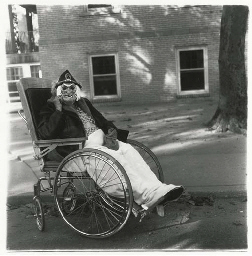 Masked Woman in a Wheelchair,