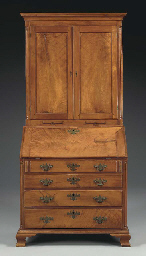 A CHIPPENDALE CHERRY-WOOD DESK