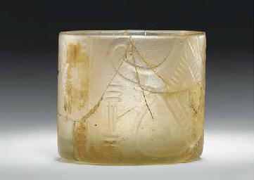 A NISHAPUR WHEEL-CUT CYLINDRIC