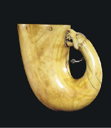 A CARVED IVORY POWDER HORN