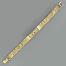 AN 18K GOLD WRISTWATCH, BY VAN