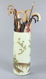 A CERAMIC UMBRELLA STAND WITH