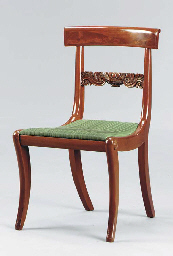 A CLASSICAL CARVED MAHOGANY SI