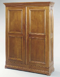 A WALNUT PANELED-DOOR WARDROBE