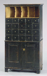 A BLACK-PAINTED APOTHECARY CAB