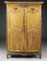 A French Provincial oak armoir