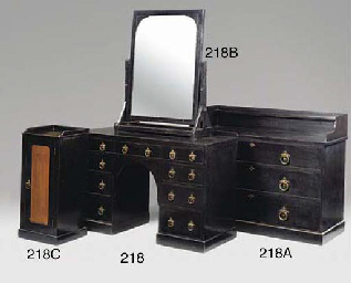 AN EBONISED PINE CHEST OF DRAW