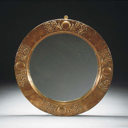 A Copper Framed Circular Mirro