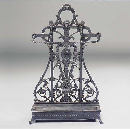A CAST-IRON UMBRELLA STAND