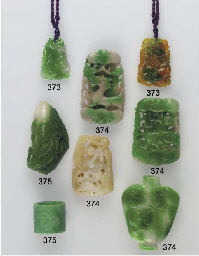 Four jadeite pendants