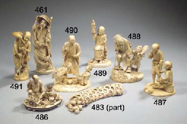 An ivory okimono figure group