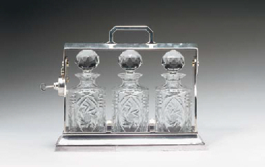 A SILVER-PLATED TANTALUS,