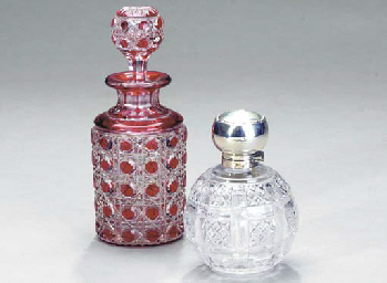 THREE DECANTERS AND STOPPERS T