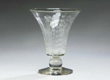 A CUT-GLASS VASE,