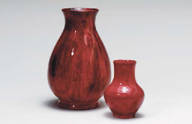 THREE RED MOORCROFT VASES, TWO
