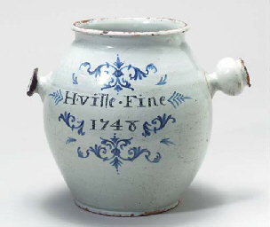 A FAIENCE DRUG JAR,