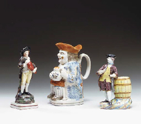 A STAFFORDSHIRE TOBY JUG TOGET