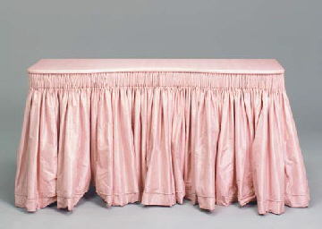 A SILK COVERED DRESSING TABLE,