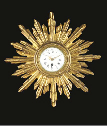 A STARBURST-FORM GILTWOOD WALL