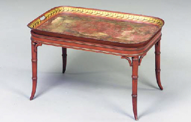A VICTORIAN TOLE TRAY ON LATER