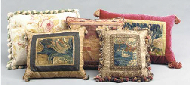 A GROUP OF CUSHIONS,