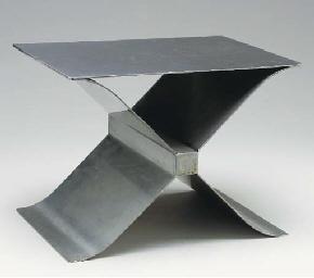 AN X-FORM METAL FOOTREST,