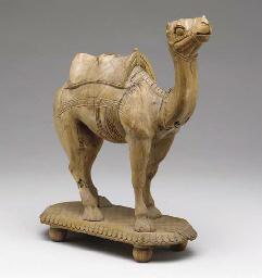 A CARVED WOOD FIGURE OF A CAME