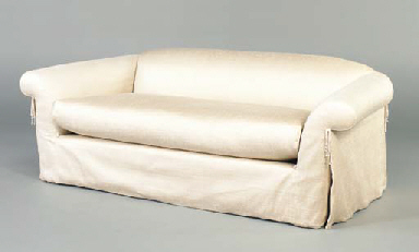A CREAM UPHOLSTERED SOFA,