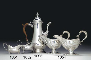 A GEORGE III SILVER COFFEE POT