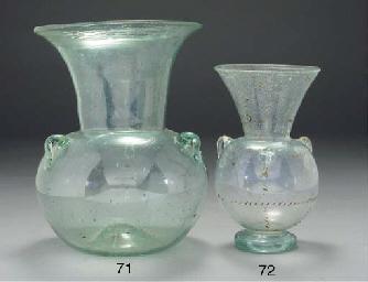 A large pale green glass mosqu