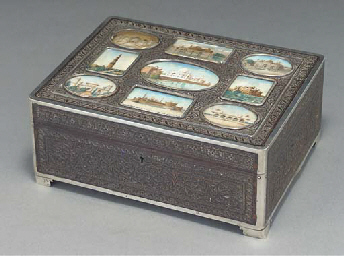 A wood box and cover with inse